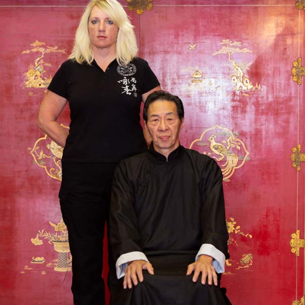 Wing Chun Woman Instructor Sifu Kimmy Squiers with Sifu Samuel Kwok